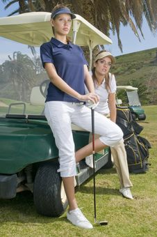 Free Beautiful Golf Players In Their Golf Cars Stock Images - 8661994