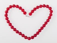Heart From Red Mardi Gras Beads Royalty Free Stock Photo