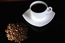 Free Coffee Cup With Highlited Coffee Beans Royalty Free Stock Image - 8664416