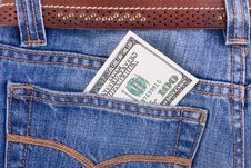 Hundred Dollar Bill In Pocket Of Blue Jeans Stock Photography