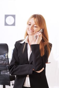 Free Businesswoman Uses Telephon Royalty Free Stock Image - 8667606