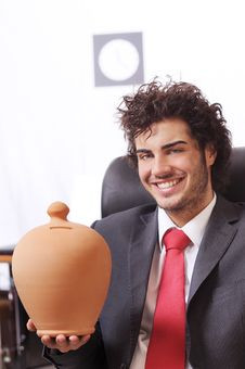 Free Businessman In The Office With Moneybox Stock Photography - 8667612