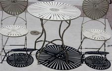 Free Shadows Of Metal Table And Chairs Stock Photography - 86691882