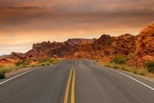 Free Gray Concrete Road Beside Brown Mountain During Golden Hour Royalty Free Stock Photos - 86694248