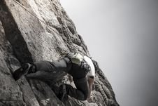 Free Climber On Cliff Face Stock Photos - 86694593