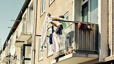 Free Low Angle View Of Clothes Hanging On Balcony Royalty Free Stock Images - 86696509
