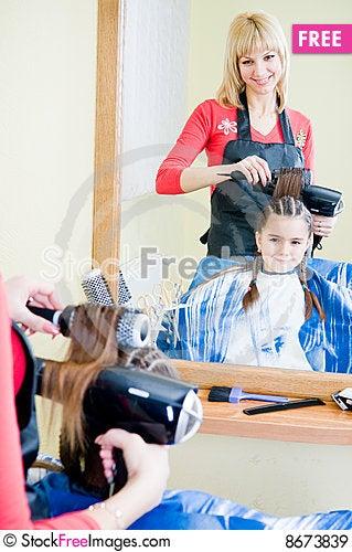 Little girl in hairdresser salon Stock Photo