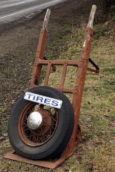Free Antique Equipment And Tire With Sign For Business Stock Image - 8671201