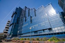 Free Shiny Glass Office Building Against Blue Sky Royalty Free Stock Image - 8671236