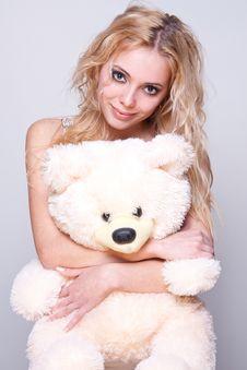 Beautiful Girl With A Teddy Bear Stock Photo