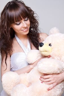 Beautiful Girl With A Teddy Bear Stock Images