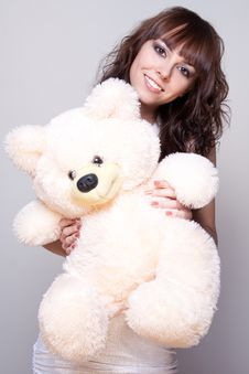 Beautiful Girl With A Teddy Bear Royalty Free Stock Image