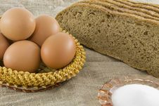 Eggs Lying In Near The Bread Royalty Free Stock Photography