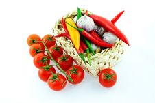 Tomatoes, Pepper And Garlic In A Basket Stock Images