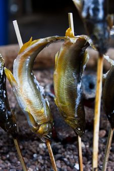 Small Fried Fishes On Sticks Royalty Free Stock Photo