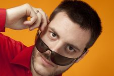 Free Man Looking Over His Sunglasses On Orange Royalty Free Stock Photography - 8688957