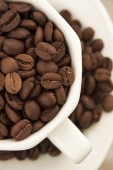 Crop Of Coffee Beans In White Cup And Plate Stock Photo