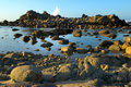 Free Rock Covered Island And Breaking Surf Royalty Free Stock Photography - 8698207