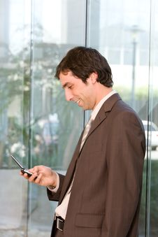 Free Business Man Holding Cellphone Stock Photos - 8692533