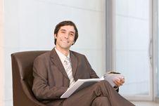 Businessman Reading Document Stock Image