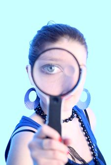 Eye Of The Girl In Magnifier Covered By Blue Light Stock Image