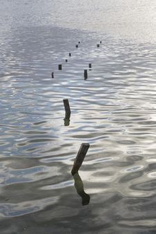 Calm Waters And Pier Remnants Stock Photography