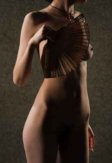 Naked Woman With A Fan Stock Photos