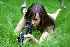 Free Model With Gun In Grass Stock Image - 874681