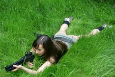 Free Girl Aiming In Grass Stock Photo - 874700