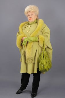 The Woman In A Green Coat. Royalty Free Stock Photography