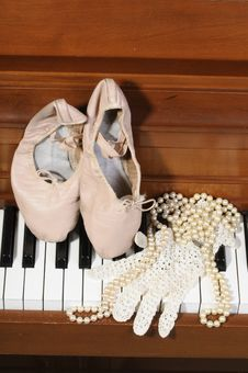Free Ballet Shoes, Lace Glove And Pearls On A Piano Stock Images - 8712564