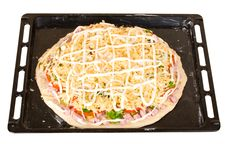 Raw Pizza On Baking Tray Royalty Free Stock Image