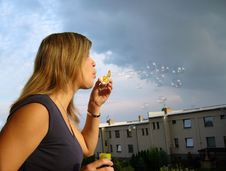 Free A Girl Blowing Soap-bubbles Royalty Free Stock Photos - 8727768