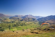 Free Paraglider In The Mountains Stock Photos - 8727953