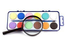 Free Magnifying Lens And Paints Royalty Free Stock Images - 8730549