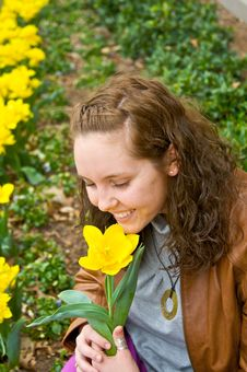 Free Pretty Girl Smelling Flower Stock Image - 8732601