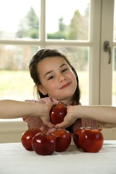 Brown Haired Child Holding An Apple Royalty Free Stock Photos