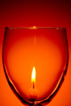 Free Lit Candle Through Wine Glass Stock Image - 8735581