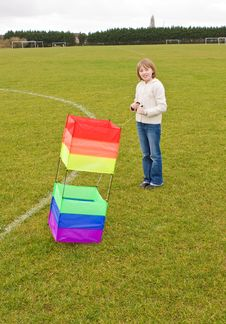 Girl With Box Kite Stock Images