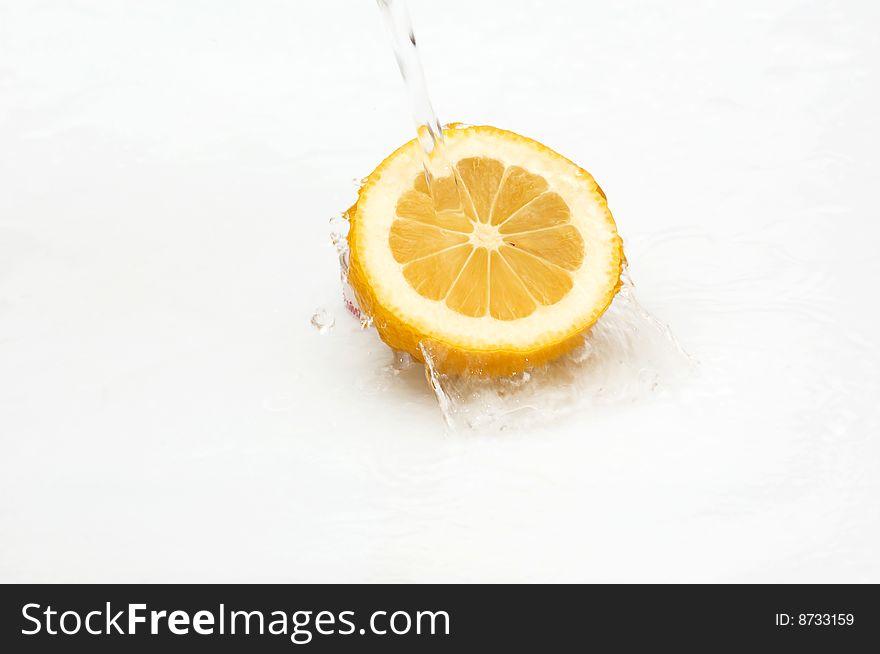 Water splash on a fresh,juicy lemon.