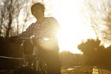 Free Man Riding Bicycle At Twilight Royalty Free Stock Photography - 87317197