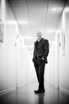 Free Full Length Portrait Of Man Standing In Corridor Royalty Free Stock Photo - 87321385