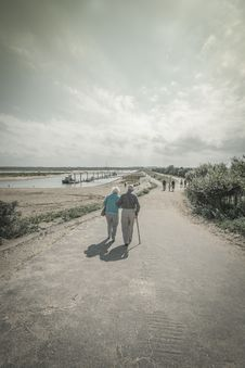Free Elderly Couple Walking Together Royalty Free Stock Photography - 87379937