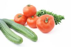 Two Cucumbers With Tomatoes Stock Images