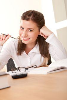 Student Series - Brunette Writing Homework Royalty Free Stock Image