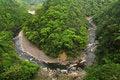 Free A Stream Runs Around A Hill Stock Image - 8752231