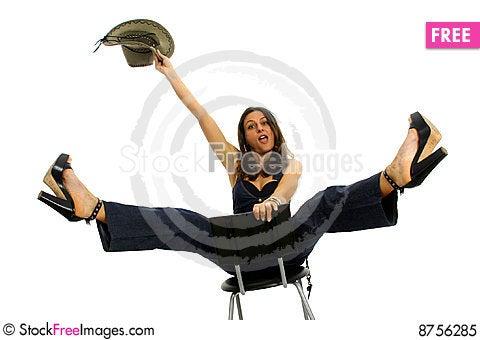 Cow-girl riding a stool Stock Photo