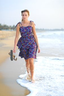 Free Beautiful Young Blond Girl Walking On Beach Royalty Free Stock Images - 8752809