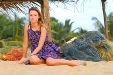 Beautiful Young Blond Girl Sitting On Beach Royalty Free Stock Photo