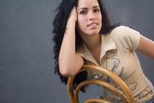 Free Young Girl Sit On A Chair Royalty Free Stock Image - 8756476